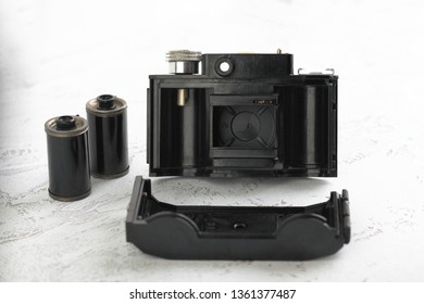 MOSCOW, RUSSIA, APRIL 07, 2019. The old Soviet 35mm. scaling film camera Smena-2, released 1960 on white cement background.