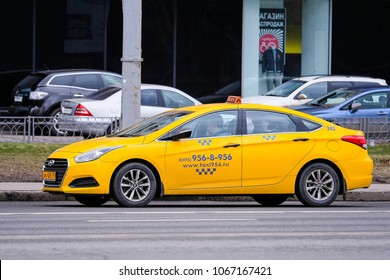 Moscow, Russia - April, 08, 2018: Taxi on a parking in a center of Moscow
