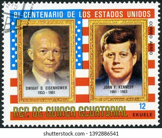 MOSCOW, RUSSIA - APRIL 09, 2019: A stamp printed in Equatorial Guinea shows Presidents John Fitzgerald Kennedy (1917-1963) and Dwight D. Eisenhower (1890-1969), 1975