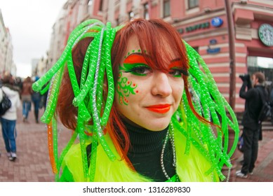 Moscow, Russia - April 10, 2011: Portrait of smiling young woman on a flashmob on Arbat in Moscow