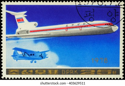 """MOSCOW, RUSSIA - APRIL 10, 2016: A stamp printed in DPRK (North Korea) shows Soviet passenger aircraft Tupolev Tu-154 and old airplane, series """"Airplanes"""", circa 1978"""