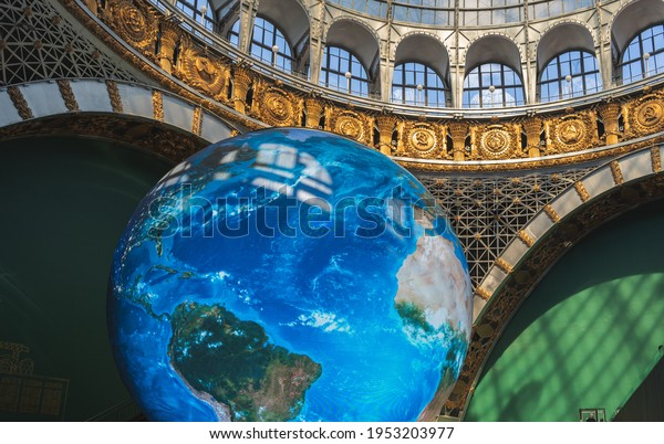 Moscow, Russia - April 10, 2021: Space Pavilion (Cosmos) at VDNKh. Contemporary Museum of Space Exploration. Model of the planet.
