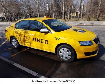 Moscow, Russia - April 11, 2017: New yellow taxi with Uber logo and inscription at the street