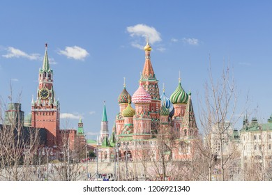 Moscow, Russia - April 11, 2018:  view from Zaryadye city park on St Basils Cathedral and Spasskaya tower of Moscow Kremlin