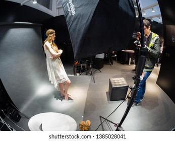 MOSCOW, RUSSIA - APRIL 11, 2019: Studio area inside Olympus Art Space booth at PhotoForum 2019 trade show and exhibition in Moscow, Russia on April 11, 2019.