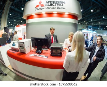MOSCOW, RUSSIA - APRIL 11, 2019: Booth of Mitsubishi Electric company at PhotoForum 2019 trade show and exhibition in Moscow, Russia on April 11, 2019.