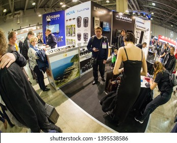 MOSCOW, RUSSIA - APRIL 11, 2019: Common booth of Nissin, Avenger, Hoya, Tokina, Ilford and Profoto companies at PhotoForum 2019 trade show and exhibition in Moscow, Russia on April 11, 2019.