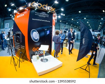 MOSCOW, RUSSIA - APRIL 11, 2019: Booth of Godox company at PhotoForum 2019 trade show and exhibition in Moscow, Russia on April 11, 2019.