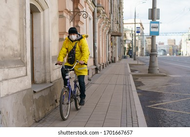 Moscow, Russia - April 11, 2020: Spring city. Photography of delivery man at the street Sretenka within day. Bike usage/ using. Frontal view. Concepts - Stay home. Coronavirus Pandemic lifestyle