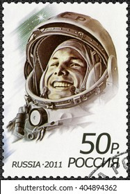 MOSCOW, RUSSIA - APRIL 12, 2011: A stamp printed in Russia shows first man in space, Yuri Alekseyevich Gagarin (1934-1968), the 50th anniversary of the first human spaceflight