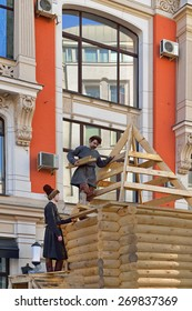 MOSCOW, RUSSIA - APRIL 12, 2015: Easter holiday will take place from 12.04.2015. Most surprising event of holiday - construction of wooden chapel, which is being built by special technology of XVII c