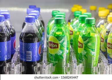 Moscow, RUSSIA - April 12, 2019: rows of Lipton and Pepsi bottles. Plastic bottle holders in vending machine