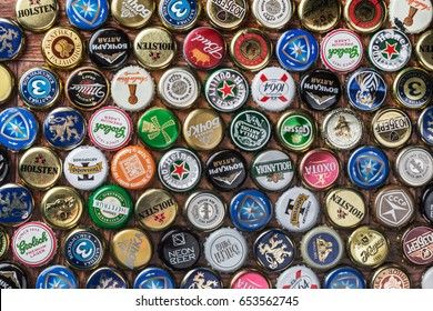 Moscow, Russia - April 13, 2017: Background of beer bottle caps, a mix of various global brands: Grolsch, Bud, Bavaria, Miller, tsingtao; corona extra; budweiser etc.