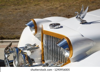 MOSCOW, RUSSIA, APRIL 14, 2018: Very beautiful, sparkling in the sun car Packard limousine of white color. Side view