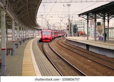 MOSCOW, RUSSIA - APRIL 15, 2015: ED4MKM-AERO aeroexpress electric train arrives to the platform of the Belarusian station in the April morning