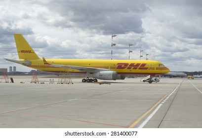 MOSCOW, RUSSIA - APRIL 15, 2015: Cargo aircraft TU-204S transport company DHL in the Parking lot of the airport Sheremetyevo