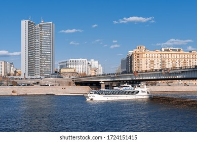 Moscow, Russia - April 15, 2017: The Radisson flotilla ship in the Moscow River floats under the Novoarbatsky bridge.