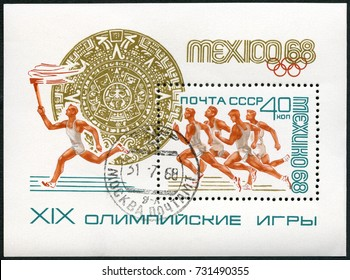 MOSCOW, RUSSIA - APRIL 15, 2017: A stamp printed in USSR shows sportsman with torch, 19th Olympic Games, Mexico City, 1968