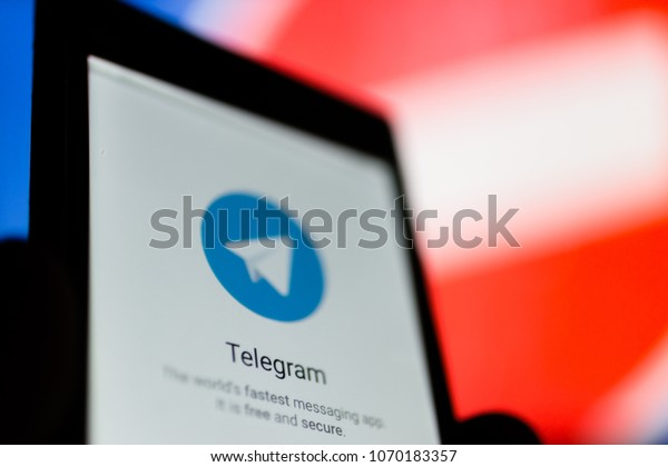 MOSCOW, RUSSIA - APRIL 16, 2018: A mobile phone with the Telegram app in hand against a prohibiting sign. In Russia, the popular Telegram messenger is banned. Roskomnadzor blocked the Telegram service