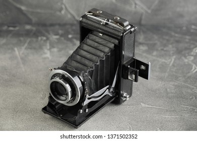 MOSCOW, RUSSIA, APRIL 16, 2019. The old Soviet Large format film camera Moscow-3, released 1951 on grey cement background. Very rare vintage camera.