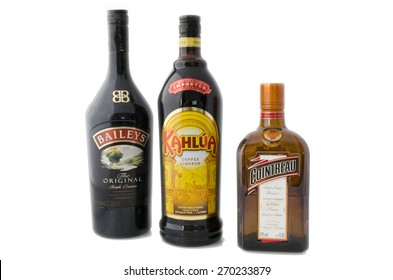 MOSCOW, RUSSIA - APRIL 17, 2015: Bottles of coffee liqueur Kahlua, triple sec Cointreau and Bailey's Irish Cream, which in equal parts form B-52 cocktail, usually served layered in shot glass.