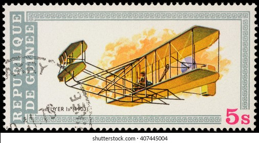 """MOSCOW, RUSSIA - APRIL 17, 2016: A stamp printed in Guinea shows flight of the first airplane of Wright brothers (1903), series """"Aviation History"""", circa 1979"""