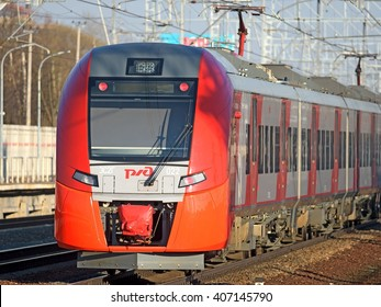 "MOSCOW, RUSSIA - APRIL 18, 2016: ""Lastochka"" commuter train on the middle track of the ""Oktyabrskaya"" railway"