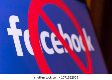 MOSCOW, RUSSIA - APRIL 19, 2018:  Logo Facebook with a red circle. Social network Facebook wants to block in Russia