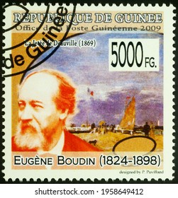 Moscow, Russia - April 19, 2021: stamp printed in Guinea shows French artist Eugene Boudin, and his painting Deauville Pier, series Paintings - by Eugene Boudin, 1824-1898, circa 2009