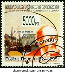 Moscow, Russia - April 19, 2021: stamp printed in Guinea shows French artist Eugene Boudin, and his painting The Brussels Canal, series Paintings - by Eugene Boudin, 1824-1898, circa 2009
