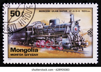 MOSCOW, RUSSIA - APRIL 2, 2017: A post stamp printed in Mongolia shows Moscow - Ulan Bator  train, Retro trains serie, circa 1979