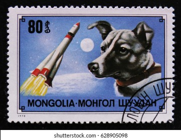 MOSCOW, RUSSIA - APRIL 2, 2017: A post stamp printed in Mongolia shows dog breed Laika (1st dog in space) and rocket, circa 1978