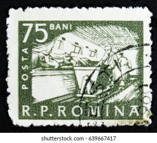 MOSCOW, RUSSIA - APRIL 2, 2017: A post stamp printed in Romania shows Cattle feeding, Farm workers, circa 1960