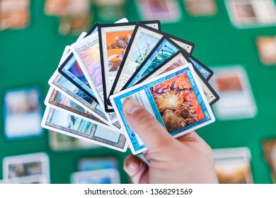 MOSCOW, RUSSIA - APRIL 2, 2019: player hold a set of cards in game of Magic: The Gathering. Magic was the first trading card game, it was released in 1993 by Wizards of the Coast