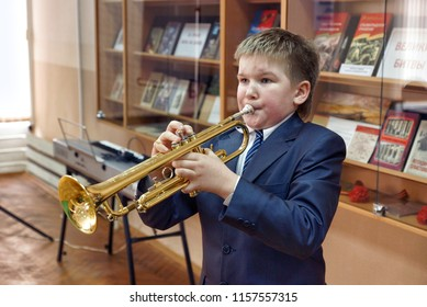 MOSCOW, RUSSIA - April 20, 2012:The boy is playing on the trumpet. Musical competition in a municipal school in Moscow.