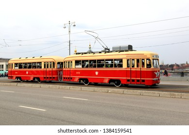 Moscow, Russia - April 20, 2019: The Parade of Trams in Moscow, annual and popular. Trams are moving along the Big Ustinsky Bridge to Chistoprudny Boulevard to their tram exhibition, and return.