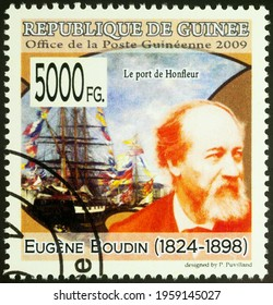 Moscow, Russia - April 20, 2021: stamp printed in Guinea shows French artist Eugene Boudin, and his painting The Port of Honfleur, series Paintings - by Eugene Boudin, 1824-1898, circa 2009