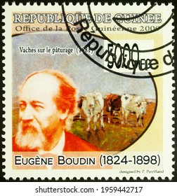 Moscow, Russia - April 20, 2021: stamp printed in Guinea shows French artist Eugene Boudin, and his painting Cows on the Pasture, series Paintings - by Eugene Boudin, 1824-1898, circa 2009