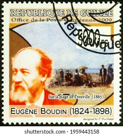 Moscow, Russia - April 20, 2021: stamp printed in Guinea shows French artist Eugene Boudin, and his painting On Trouville Beach, series Paintings - by Eugene Boudin, 1824-1898, circa 2009