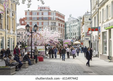 Moscow, Russia, April 25, 2016:  Pedestrians on the street Kuznetsky Bridge, spring day. The street is decorated as part of the Moscow Spring Festival.