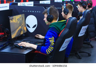 Moscow, Russia, April, 2018: Young gamers in headphones playing at the computer on a e-sport tournament (editorial)
