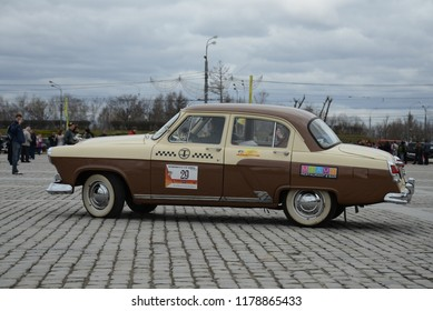 MOSCOW, RUSSIA - APRIL 21, 2013: Volga GAZ-M21 Taxi made in USSR 1960s classic car at retro cars rally start on moving.