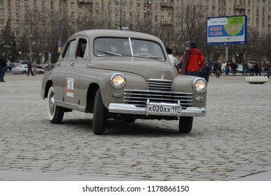 MOSCOW, RUSSIA - APRIL 21, 2013: GAZ-M20 Podeda made in USSR 1940s classic car at retro cars rally start on fast moving.