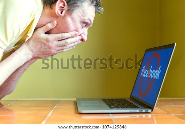 MOSCOW, RUSSIA - APRIL 21, 2018: A young man is upset near a computer. in Russia Roskomnadzor blocked the social network Facebook
