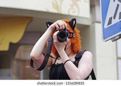 Moscow, Russia - April 22, 2012: Portrait of a young woman with animal ears taking pictures on a flashmob on Arbat in Moscow