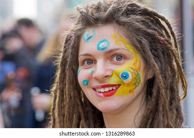 Moscow, Russia - April 22, 2012: Portrait of smiling young woman with dreadlocks on a flashmob on Arbat in Moscow