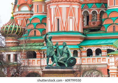 MOSCOW, RUSSIA - APRIL 22, 2012: The Monument to Minin and Pozharsky is a bronze statue on Red Square in Moscow, Russia, in front of Saint Basils Cathedral.