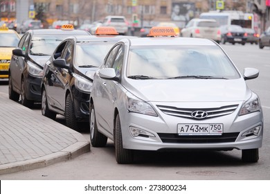 MOSCOW, RUSSIA - APRIL 22, 2015: Taxis waits for passengers. Taxi cars on the street of Moscow