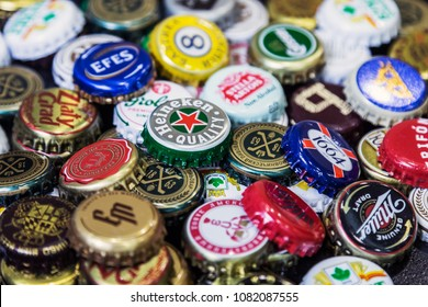 Moscow, Russia - April 22, 2018: Background of beer bottle caps, a mix of various global brands: Grolsch, Bud, Bavaria, Miller, Heineken, Baltika; corona extra etc.
