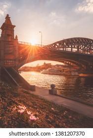 Moscow, Russia - April 22, 2019:Primroses at sunset. The lights of a sun. Bridge and Gorky Park. Ship flotilla Radisson.
